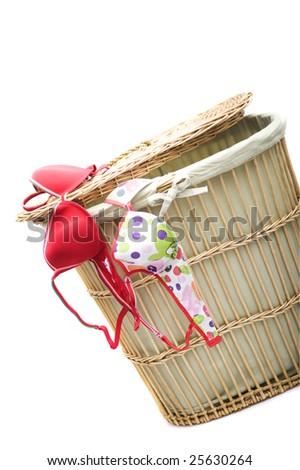 laundry and basket over white - stock photo