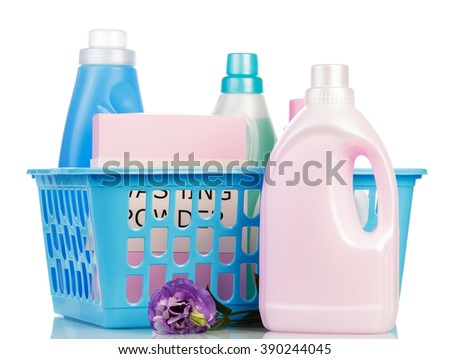 Laundry basket and plastic bottles with detergent isolated on white background.