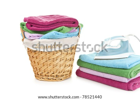 Laundry Basket and towels with iron on them - stock photo