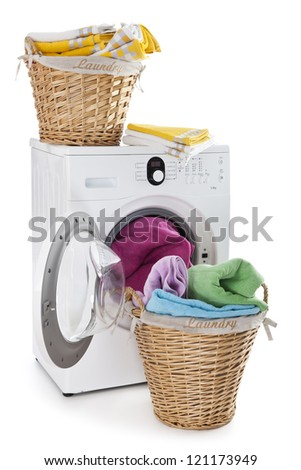 Laundry basket on a washing machine isolated on white background - stock photo