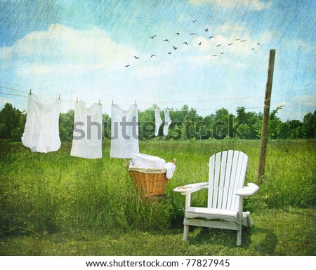 Laundry drying on clothesline on beautiful summer's day - stock photo