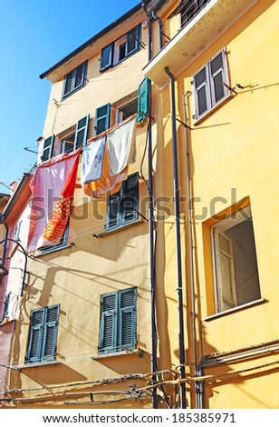 Laundry hanging out of a typical italian facade. Italy - stock photo