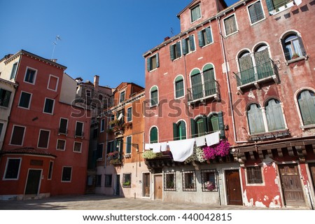 Laundry hanging out of a typical Venetian facade - stock photo