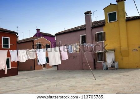 Laundry hanging out of typical houses of Burano Island - Venice,  Italy - stock photo