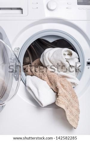 Laundry in the washing machine - stock photo