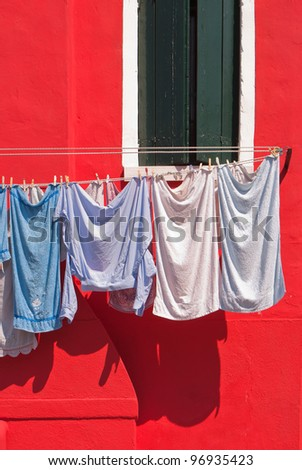 Laundry is hung to dry above an Italian street. - stock photo