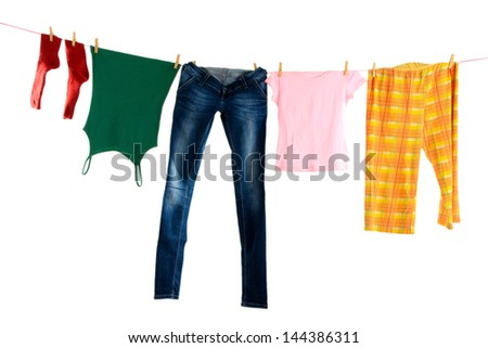Laundry line with clothes isolated on white - stock photo
