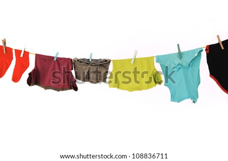 Laundry line with clothes on a white backround - stock photo