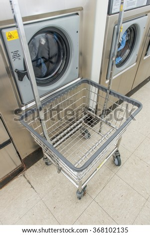 Laundry Machine and a cart in store - stock photo