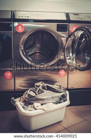 Laundry machines at laundromat shop. - stock photo