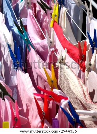 laundry - many clothes with clothespins on lines - stock photo