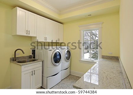 Laundry room in luxury home with large washer and dryer - stock photo
