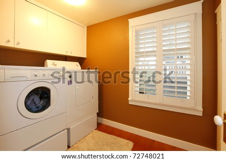 Laundry room with gold colors - stock photo