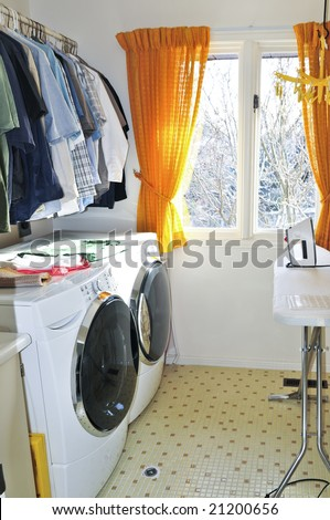Laundry room with modern washer and dryer - stock photo