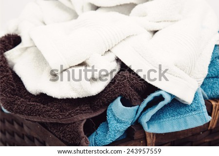 Laundry. Wicker basket with dirty towels - stock photo