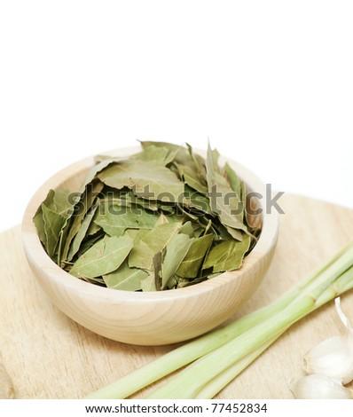 laurel leafs in a wooden board - stock photo
