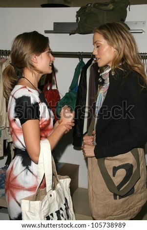 Lauren Bush and Elizabeth Berkley  at the FEED LA Launch Party. Fred Segal, Santa Monica, CA. 03-12-09