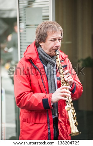 LAUSANNE, SWITZERLAND - APR 13: A member of the Gilles Remy jazz Band playing clarinet in the morning of 13 April at Lausanne, Switzerland