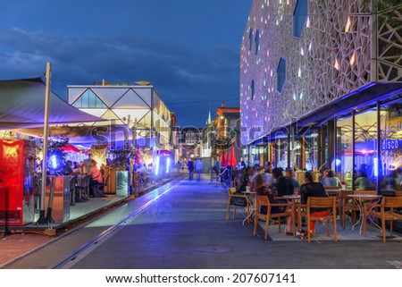 LAUSANNE, SWITZERLAND - JUNE 26: Night scene in Flon, Lausanne, Switzerland on June 26, 2014. The ancient storehouse-district has recently been restored featuring several modern buildings and spaces. - stock photo