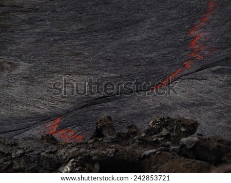 Lava burst inside the Erta Ale volcano. This lava lake is continuously flowing and bubbling inside this 60m-large crater. Located in Ethiopia, close to the border with Erithrea. - stock photo
