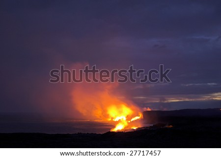 Lava erupting into Pacific Ocean at night on Big Island