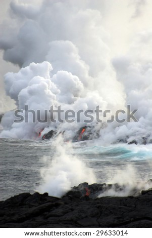 Lava erupting into Pacific Ocean during day on Big Island - stock photo