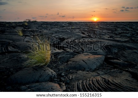 Lava field close to Kona at sunset, Big Island, Hawaii - stock photo