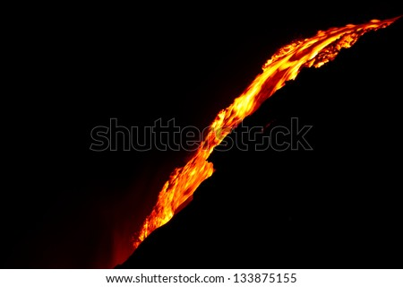 Lava flow at night in Hawaii - stock photo