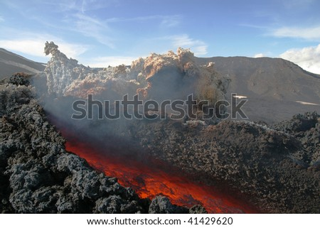 Lava flow  from a flank eruption at volcano Etna in Sicily - stock photo