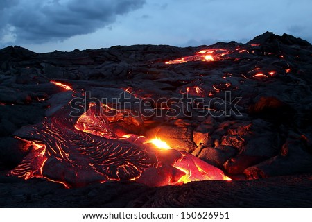 Lava flowing at twilight, Big Island, Hawaii - stock photo