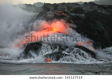Lava flowing  into Pacific Ocean on Big Island, Hawaii - stock photo