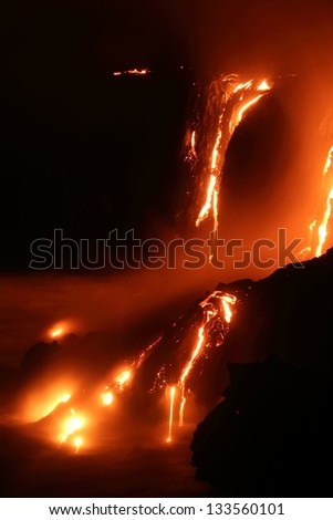 Lava flowing into the ocean, Big Island, Hawaii - stock photo