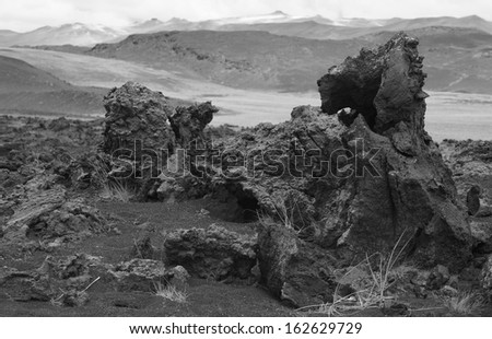 Lava formations and mountains in desert landscape Iceland