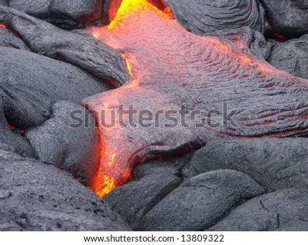 Lava print: detail of flowing lava magma stream. - stock photo