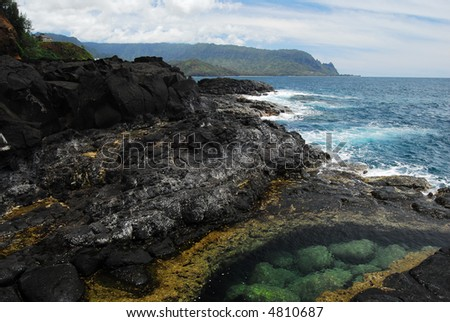 Lava rock formations next to the Pacific in Hawaii - stock photo