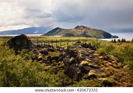 Lava rocks and Thingvallavatn lake in Thingvellir national park, Iceland - stock photo