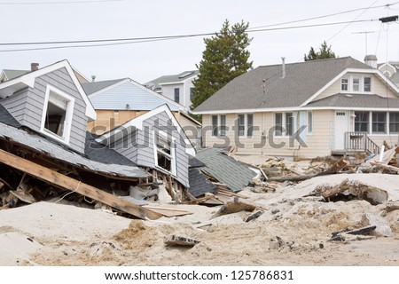 LAVALLETTE, NJ - JAN 13: The remnants of homes destroyed after Hurricane Sandy struck the shore in October 2012 on January 13, 2013 in Lavallette, New Jersey. Clean up continues 75 days later. - stock photo