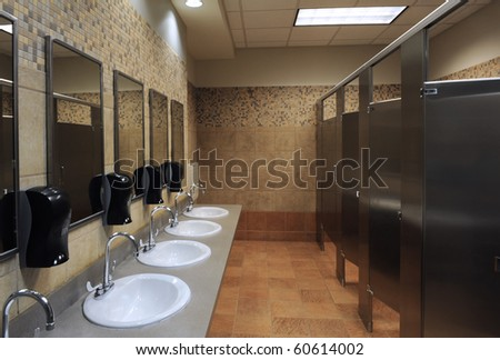 lavatory sinks in a public restroom - stock photo