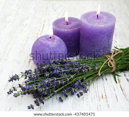 Lavender and candles on a wooden background - stock photo
