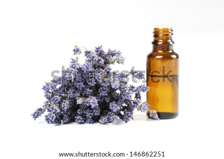 Lavender and essential oil on white background - stock photo