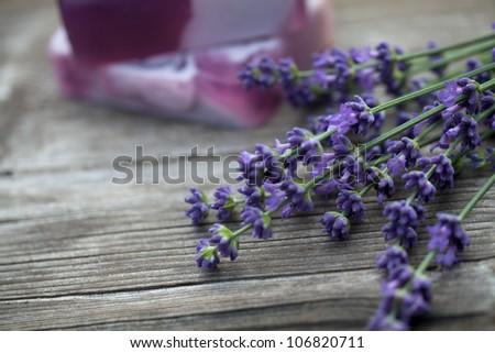 lavender and lavender soap over wood - stock photo