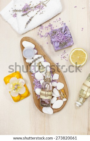 Lavender and lemon aromatherapy. Fresh lavender and lemon spa treatment with  ingredients on wooden background. - stock photo