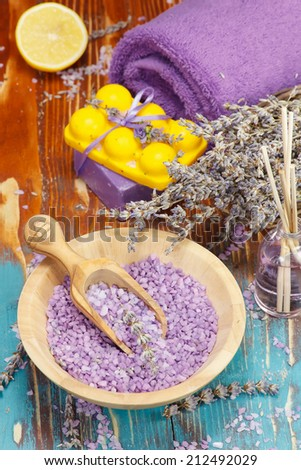 Lavender and lemon aromatherapy. Natural handmade lavender oil, soap with bath salt, lemon and lavender on rustic wooden background.  Macro, selective focus - stock photo
