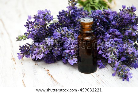 Lavender and massage oil on a old wooden background - stock photo