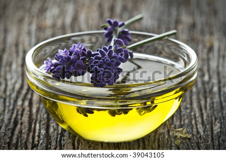 lavender and oil on wooden board close up - stock photo
