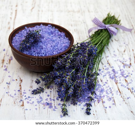 Lavender and  sea salt  on a wooden background - stock photo