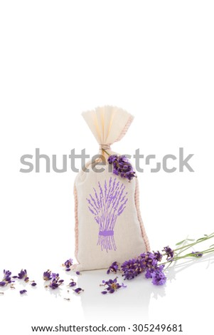 Lavender aromatherapy. Lavender herbs and bag with dry lavender isolated on white background. Alternative medicine. - stock photo