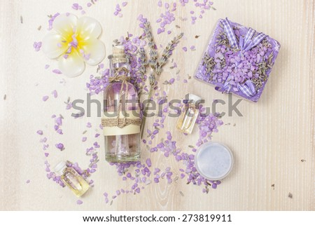 Lavender Beauty Products. Various lavender  beauty products on the wooden board. - stock photo