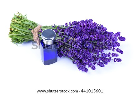 Lavender bouquet and blue perfume bottle isolated on white background - stock photo