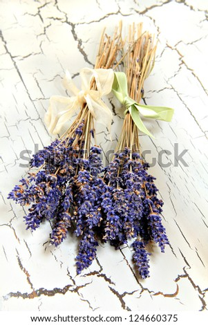 Lavender bunches on a rustic table top. - stock photo